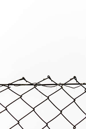 inaccurate: Chain link fence in front of white , symbol of frontier, network, open space