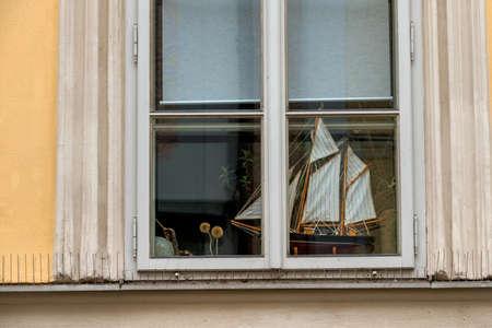 long haul journey: ship model in a window icon for hobby, marine, wanderlust, Stock Photo