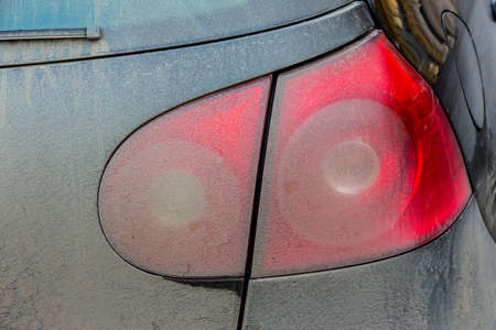 pkw: spotted tail light on cars, symbol of dirt, risk of accidents, congestion, poor care