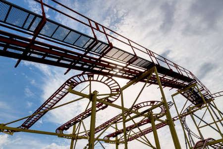 tortuous: abandoned roller coaster, icon fair, stop, ups and downs