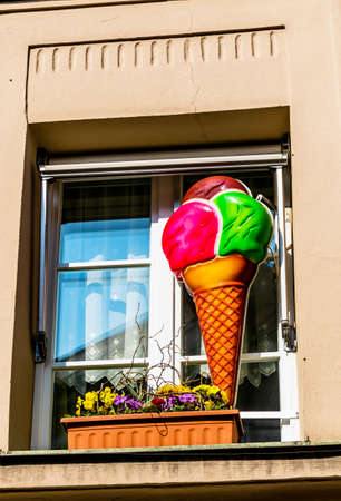 leis: advertisement for waffeleis outside the window, icon for catering, ice cream parlor, advertising