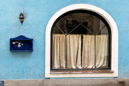 slowdown: closed inn blue facade, a symbol of economic slowdown, gastronomy, crisis