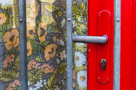 self contained: doorknob, lattice, floral pattern, symbol of insolvency, end business task Stock Photo