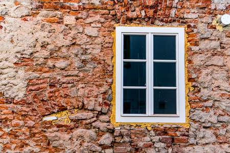 renovate old building facade: house masonry restoration, symbol of insulation, renovation, botch