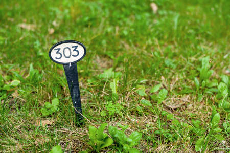 localization: sign marks a spot in the grass