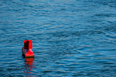 oceanography: red buoy water surface, symbol of navigation, security, navigation Stock Photo
