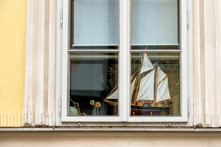 modell: ship model on the window sill, symbol for traveling, sailing, wanderlust