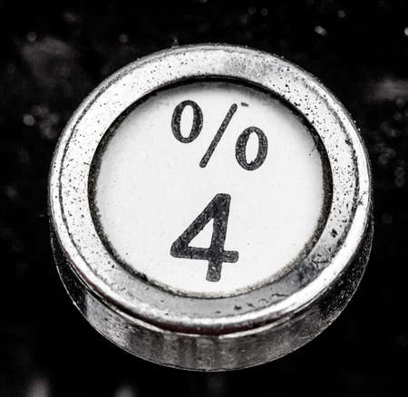 cheaper: sign percent on a typewriter. symbolic photo for communication in former times