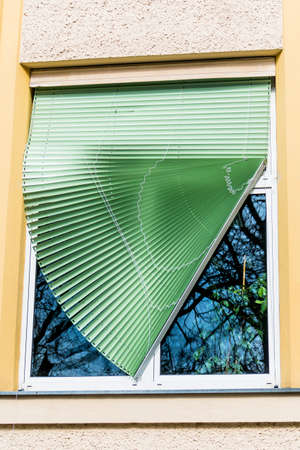 a blind: broken blinds on a window at a school in linz, austria