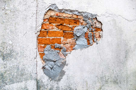 house wall broken masonry, symbol of decay, rehabilitation needs and damage 写真素材