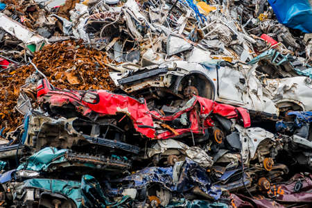 sponsoring: old cars were scrapped in a trash compactor. scrap iron and scrapping premium for car wrecks