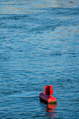 hydrology: red buoy water surface, symbol of navigation, security, navigation Stock Photo