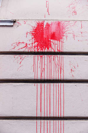 red ink splashes on a wall, icon red, criminal damage, vandalism Stock Photo