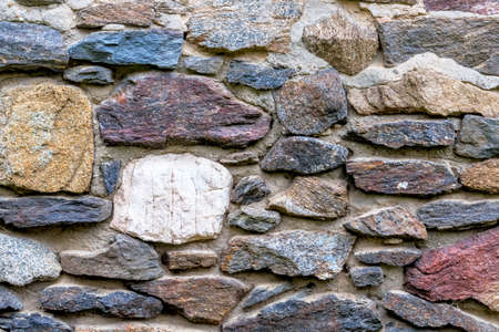 hardness: masonry colored natural stone, symbol of texture, background, individuality
