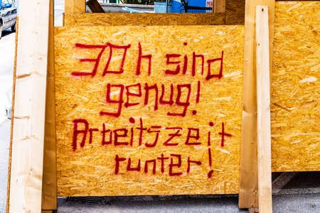 working hours: at a construction site is a sign of aufschrifft: thirty hours are enough. symbolic photo for shorter working hours Stock Photo