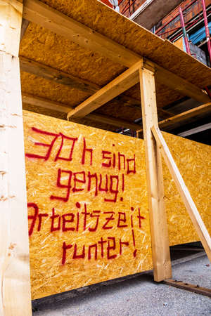 rewarding: at a construction site is a sign of aufschrifft: thirty hours are enough. symbolic photo for shorter working hours Stock Photo