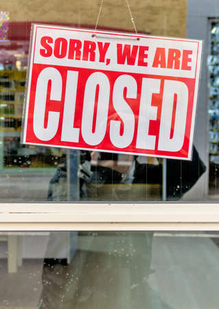 doldrums: sorry we are closed sign, symbol for retail, bankruptcy, crisis, end