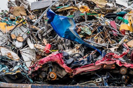 spares: old cars were scrapped in a trash compactor. scrap iron and scrapping premium for car wrecks