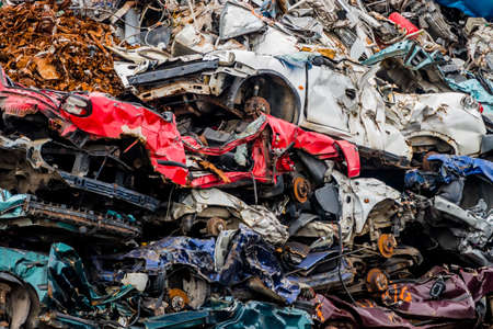 scrap iron: old cars were scrapped in a trash compactor. scrap iron and scrapping premium for car wrecks