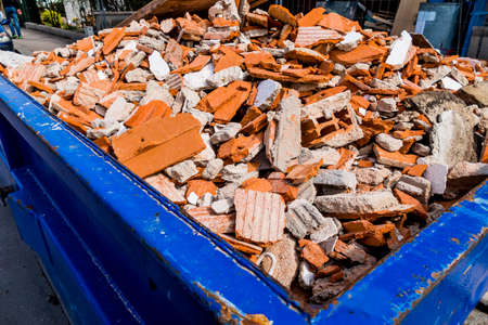immobilien: construction debris at a construction site during renovation work in a container. house is being renovated.