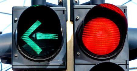 a traffic light with retoem light. green light for left turn.