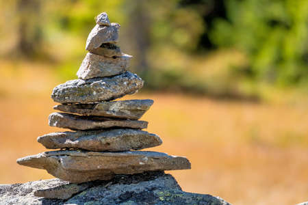 cone shaped: stacked stones, symbol for hiking, marking, orientation