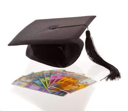 examiert: mortar board and the swiss franc. symbol for education costs. Archivio Fotografico