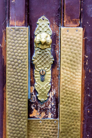 immobilien: the door handle on the front door of an old house in the city