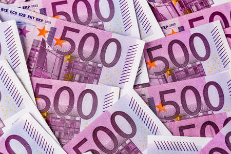 adjacent: many five hundred euro banknotes are adjacent. symbolic photo for wealth and investment
