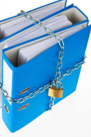 insider information: a file folder with chain and padlock closed. privacy and data security.