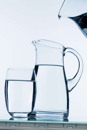 carafe: water is poured into a carafe, symbolfoto for drinking water, freshness, demand and consumption Stock Photo