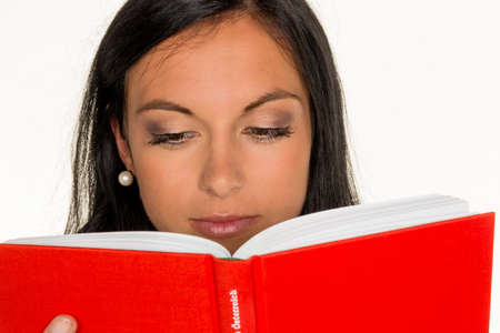 well read: a young woman reading a book with a red cover