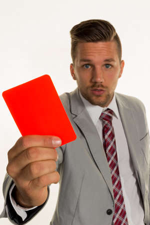 arbeitsrecht: a manager holding a red card in hand. symbolic photo for resignation or dismissal Stock Photo