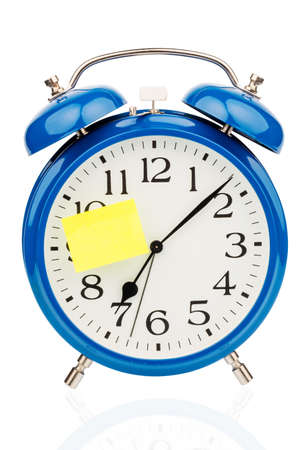 transience: an alarm clock with a sticky note: school as a symbol photo for starting school