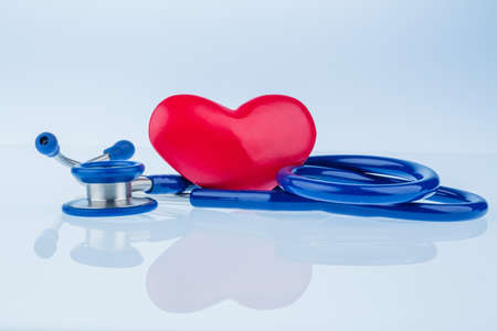 lovesickness: a heart and a stethoscope are adjacent. symbolic photo for heart disease and heartache.