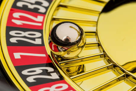 decided: the cylinder of a roulette gambling in a casino. winning or losing is decided by chance. Stock Photo