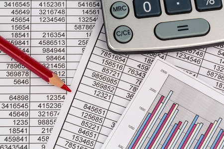 vat: a calculator is located on the numbers a balance us statistics. photo icon for sales, profits and costs.