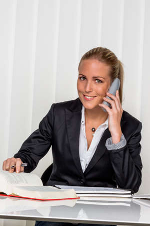 legislator: businesswoman sitting in an office. symbol photo for managers, self or lawyer.