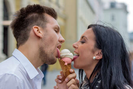 leis: a young couple with a bag of ice. ice cream cones as refreshment in summer