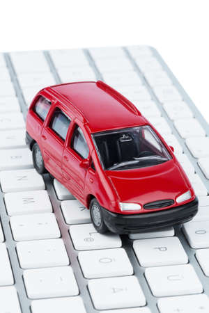 auto leasing: car on keyboard, symbol photo for car purchase and car dealership on the internet
