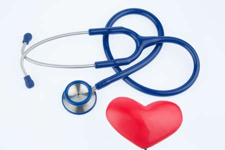 stethoscope and a heart symbol photo for cardiovascular risk and heart attack