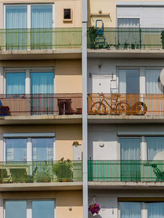 immobilien: many balconies in an apartment building for several parties in a city.