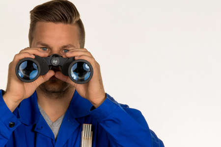 doldrums: a worker in a business enterprise (craftsmen) with binoculars looking for jobs or jobs