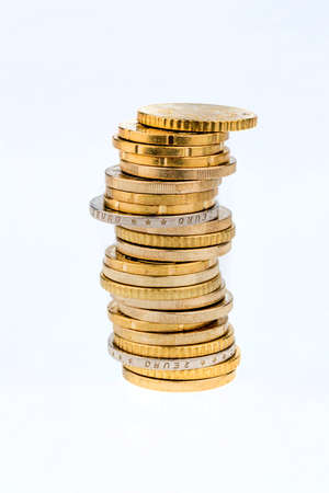 thrift: stack money coins against white background, symbol photo for saving, thrift, small savers