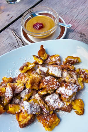 changing course: pancakes and apple sauce, typical dish in austria