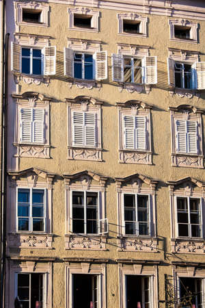 rentals: old building, facade with lattice windows and shutters Stock Photo