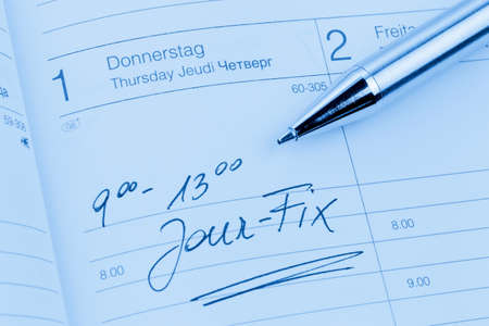 entered: an appointment is entered on a calendar: jour fix Stock Photo