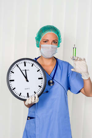 surgery expenses: a nurse or doctor in surgical clothing before surgery. symbolic photo for stress and overtime in the hospital.