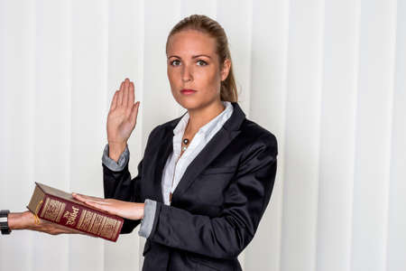 summons: a woman says as a witness in court in a lawsuit. will be sworn in and swears on the bible.
