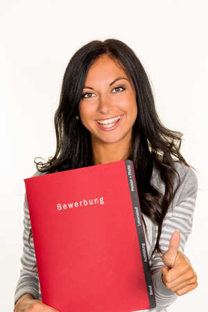 a young woman holding a folder for the application in an open job in hand.